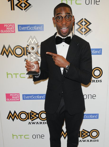 Tinie Tempah holding his Mobo Awards 2013