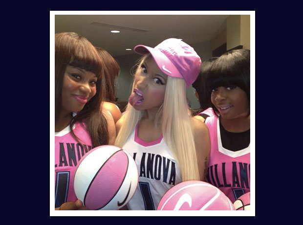 Nicki Minaj with two pink basketballs