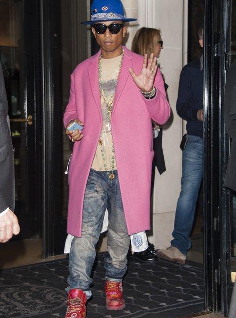 Pharrell wearing a pink coat in Paris