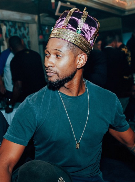Usher wearing a crown
