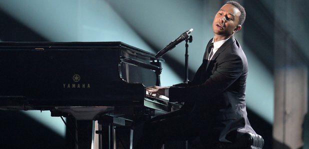 Common and John Legend perform at the Grammy Award