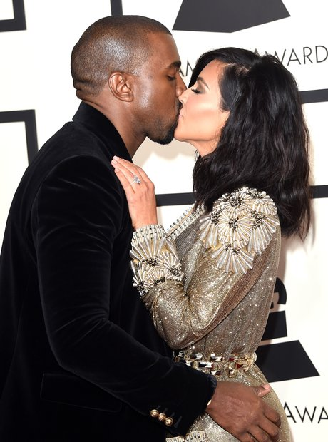 Kanye West and Kim Kasdashian kiss