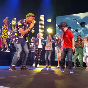 Pharrell dancing with kid