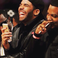 Image 1: Drake laughing with phone in hand