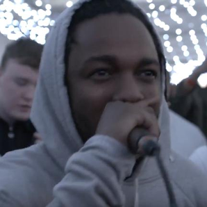 Kendrick Lamar holding microphone