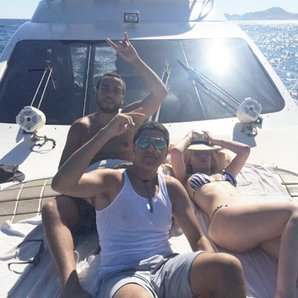 Iggy Azalea and French Montana on a yacht