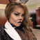 16. Lil Kim went down the cute route as a monochrome Halloween cat.